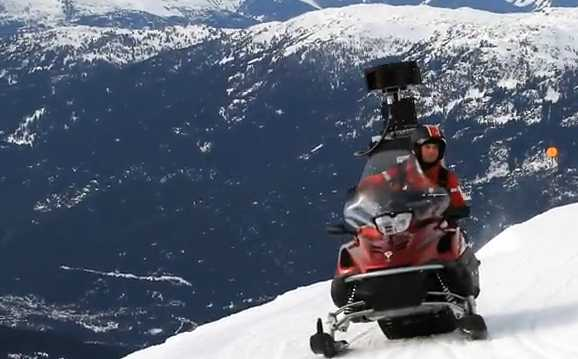 image of google street view capturing snow mobile on mountain slope skiing location